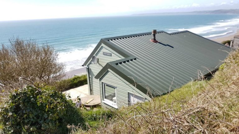 Windwhistle Chalet perched on cliff